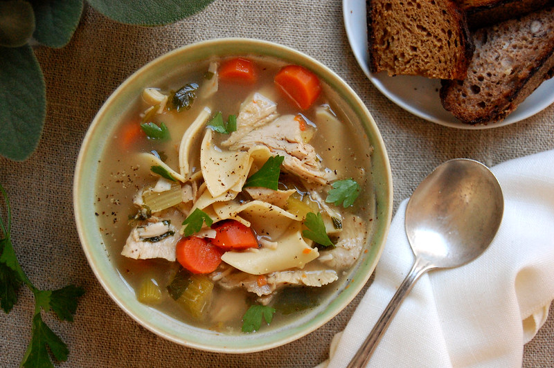 bowl of thanksgiving leftovers turkey soup with bread
