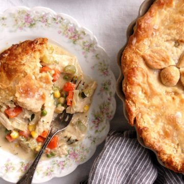 baked deep-dish turkey or chicken pot pie with piece on place