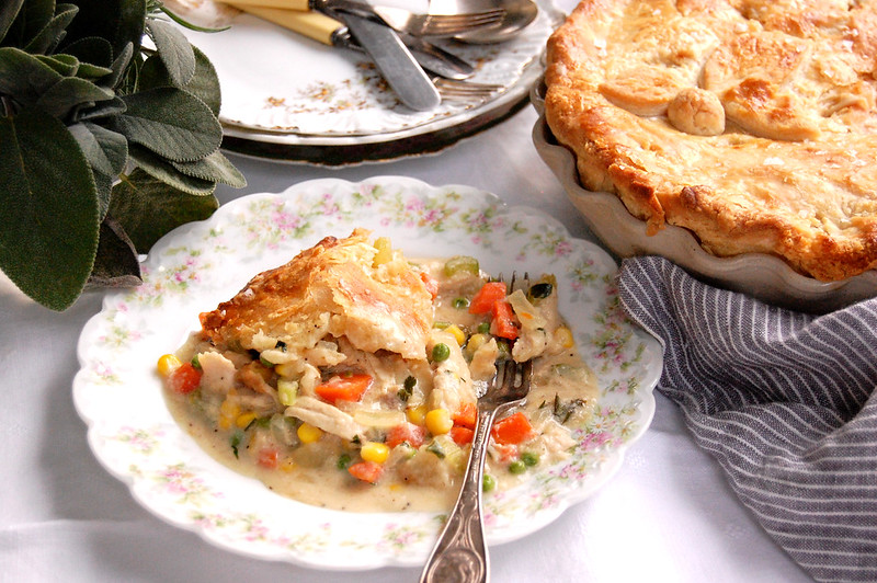baked deep-dish pot pie with piece on plate