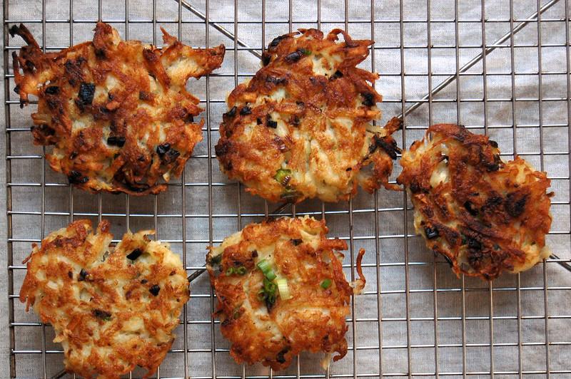 crispy brown potato latkes on cooling rack