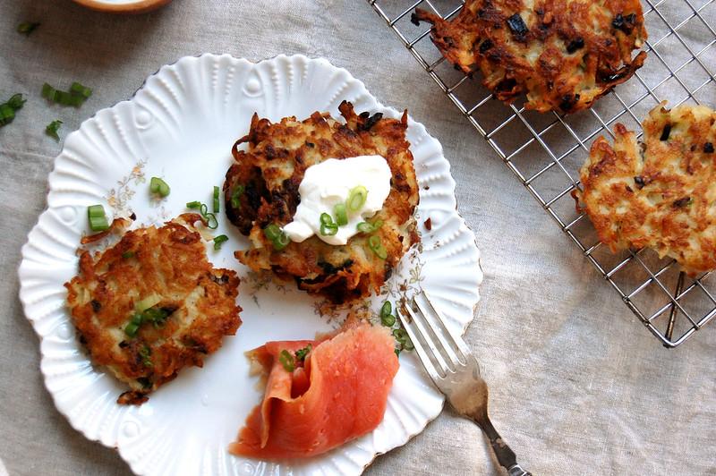 crispy potato latkes on plate with salmon and sour cream