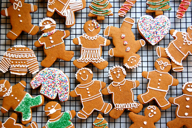 baking rack filled with decorated gingerbread cookies like people