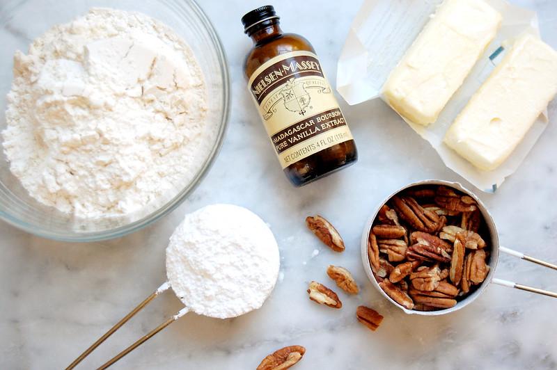 ingredients for cookies (Russian Tea Cakes) vanilla, pecans, flour, sugar, butter