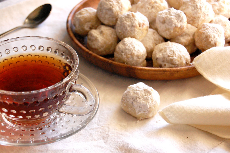 plate of snowball cookie mexican wedding cookies russian tea cakes with cup of tea