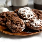 plate of double chocolate cookies with hot cocoa