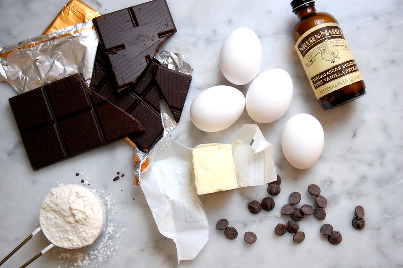 ingredients for chocolate cookies chocolate eggs butter chips flour vanilla