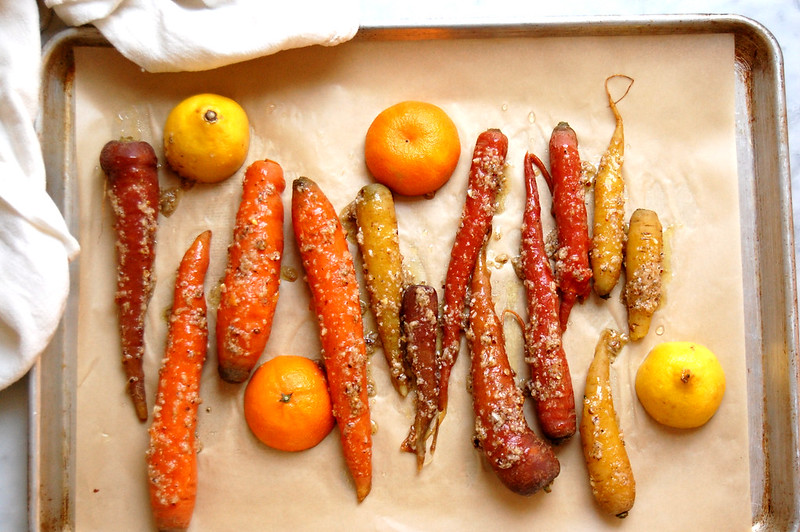 carrots and citrus on roasting pan