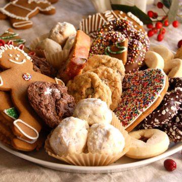 assorted Christmas cookies on platter sugar cookies, gingerbread, wedding cookies, chocolate cookies