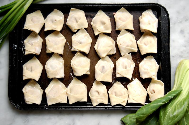 raw wontons on baking sheet for soup