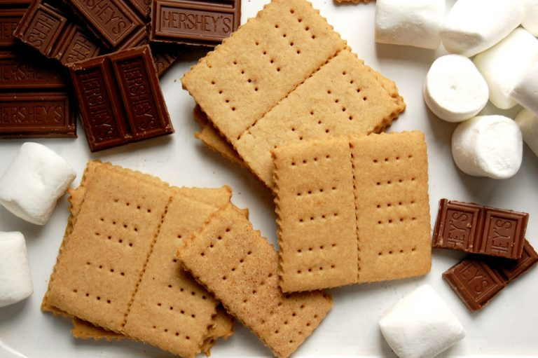 tray of homemade graham crackers with chocolate and marshmallows