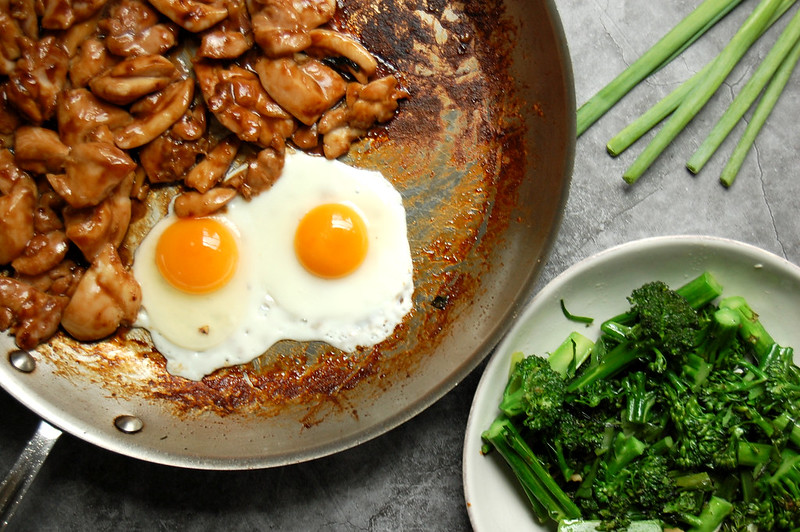 sautéed chicken with fried egg and Chinese broccoli