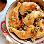braising pan with chicken legs olives and dates