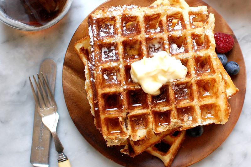 overhead shot of JFK favorite waffles with butter and syrup