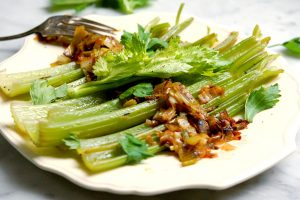 platter of braised celery and leeks on serving dish