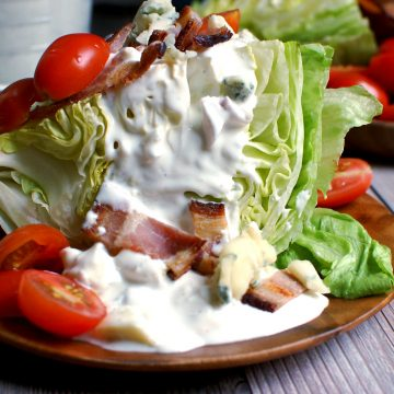 wedge salad with blue cheese dressing with bacon and sliced tomatoes