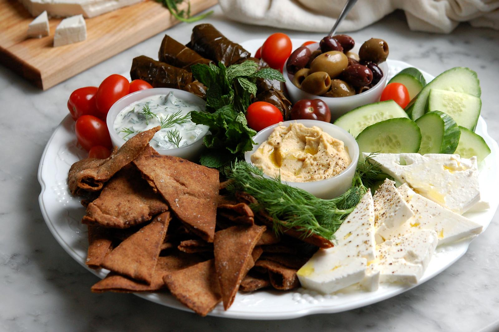 mezze platter with hummus tzatziki pita olives and feta