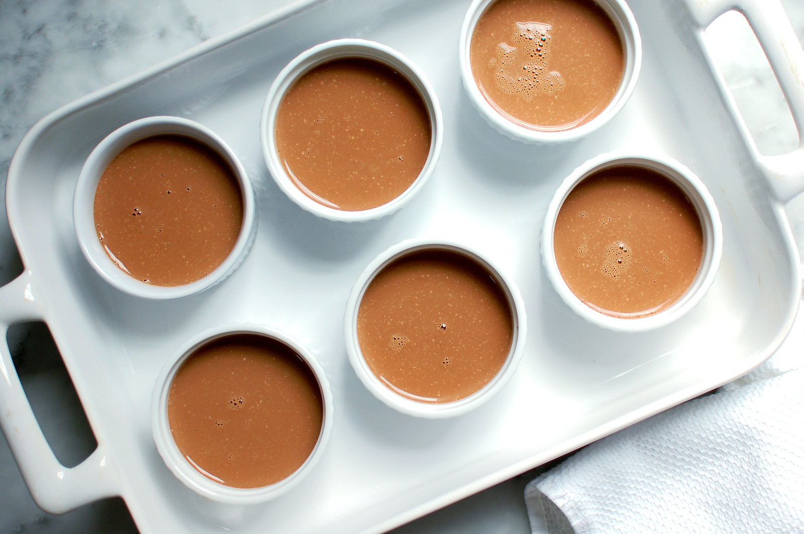 puddings in ramekins ready for bain marie and oven