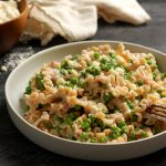 bowl of creamy easy pasta with pancetta and peas