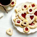 valentine's day linzer sugar cookies with jam on dessert plate