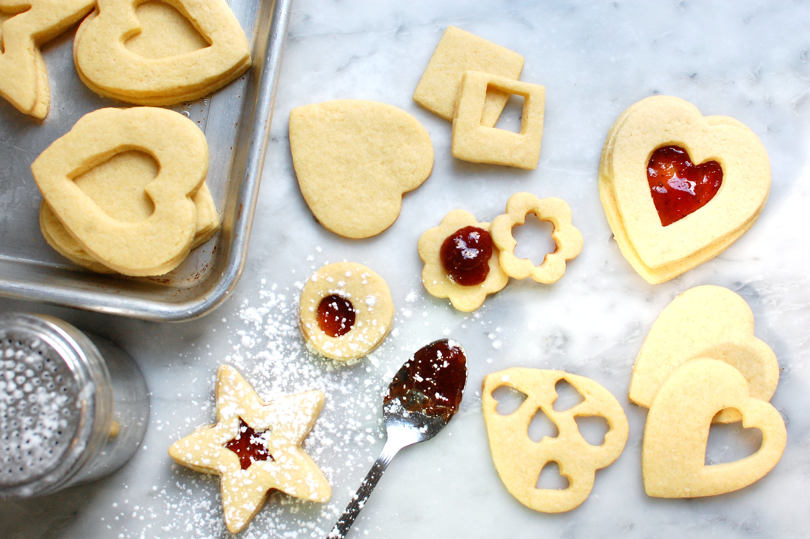 filling heart linzer sugar cookies with jam