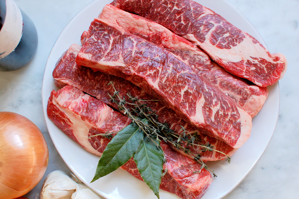 raw beef short ribs on plate