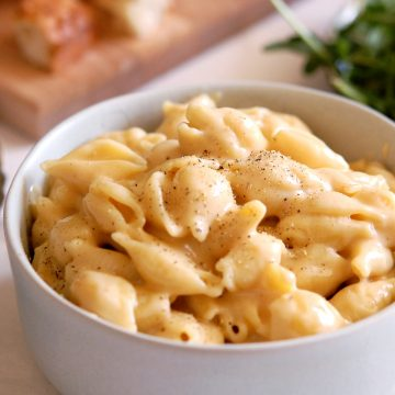 bowl of creamy stovetop mac and cheese with spoon