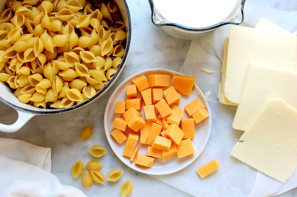 ingredients for macaroni and cheese with american and cheddar cheeses