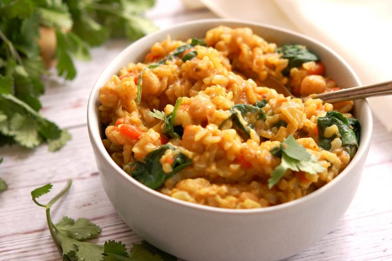 bowl of chickpea kitchari with cilantro and spinach on top for dinner