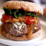 stuffed blue cheese burger with caramelized onions on bun