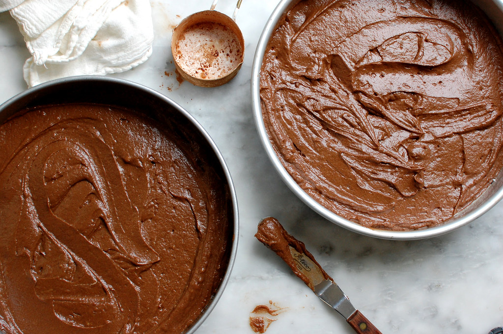 unbaked chocolate stout cake in cake pans
