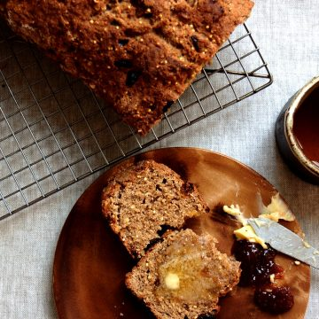 loaf of buttermilk Irish brown soda bread sliced with butter