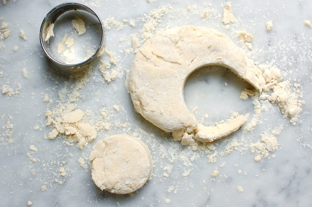 raw biscuit dough being cut out