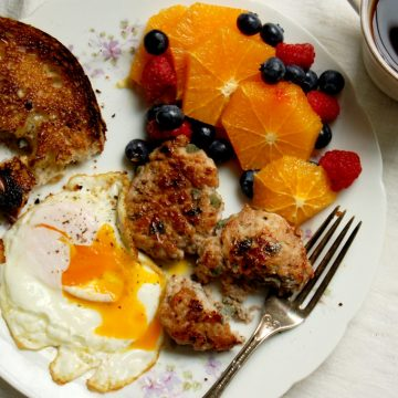 mother's day 2021 recipes for breakfast and brunch eggs sausage fruit on plate