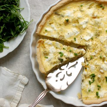 slices of easy quiche in pan with chives