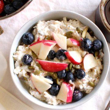 bowl of Bircher muesli overnight oats with apple yogurt and oatmeal