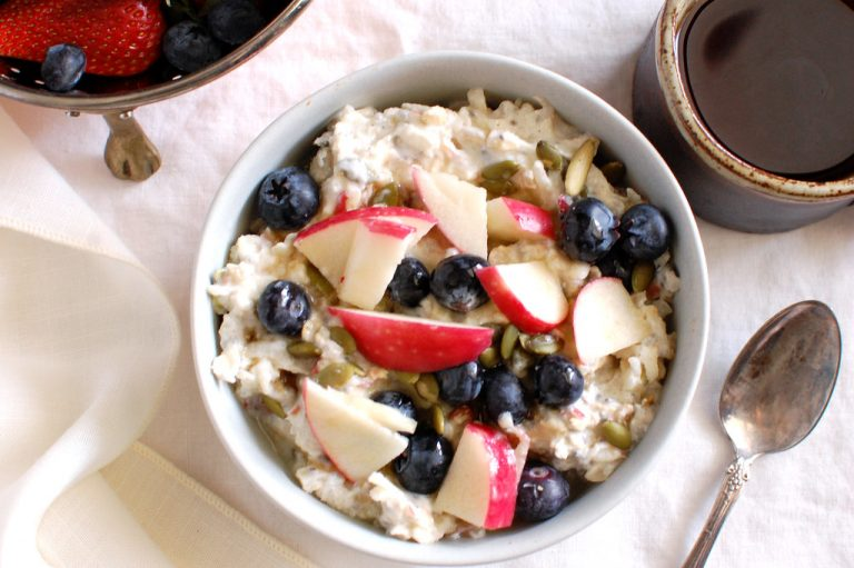 bowl of Bircher muesli overnight oats with apple yogurt and oatmeal