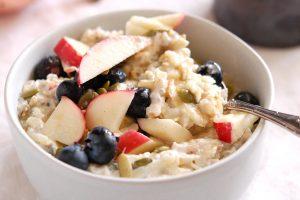 bowl of Bircher muesli easy overnight oats with apple yogurt and oatmeal