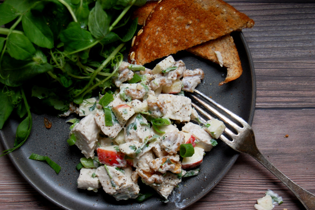 Waldorf chicken salad recipe on plate with toast and greens