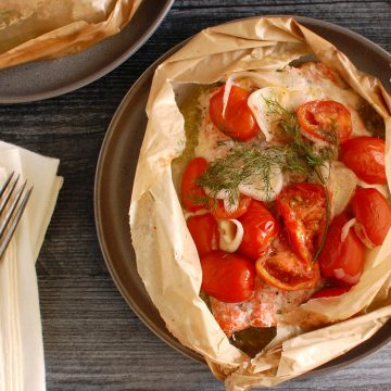 baked salmon en papillote in parchment envelope for dinner