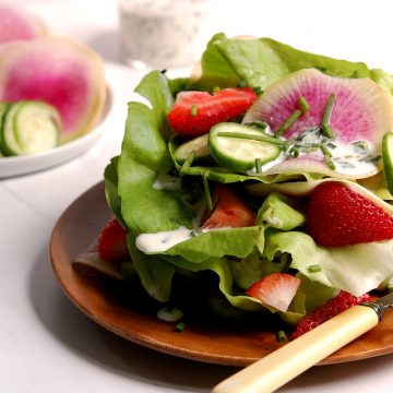 strawberry salad with Bibb lettuce and buttermilk dressing on dish
