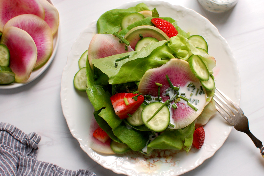 salad with bibb lettuce strawberries and buttermilk dressing on dish