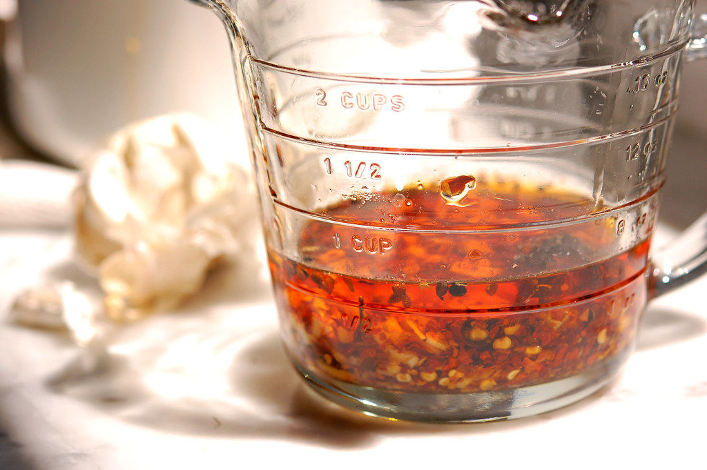 Chinese chili oil homemade in glass jar with garlic for noodles