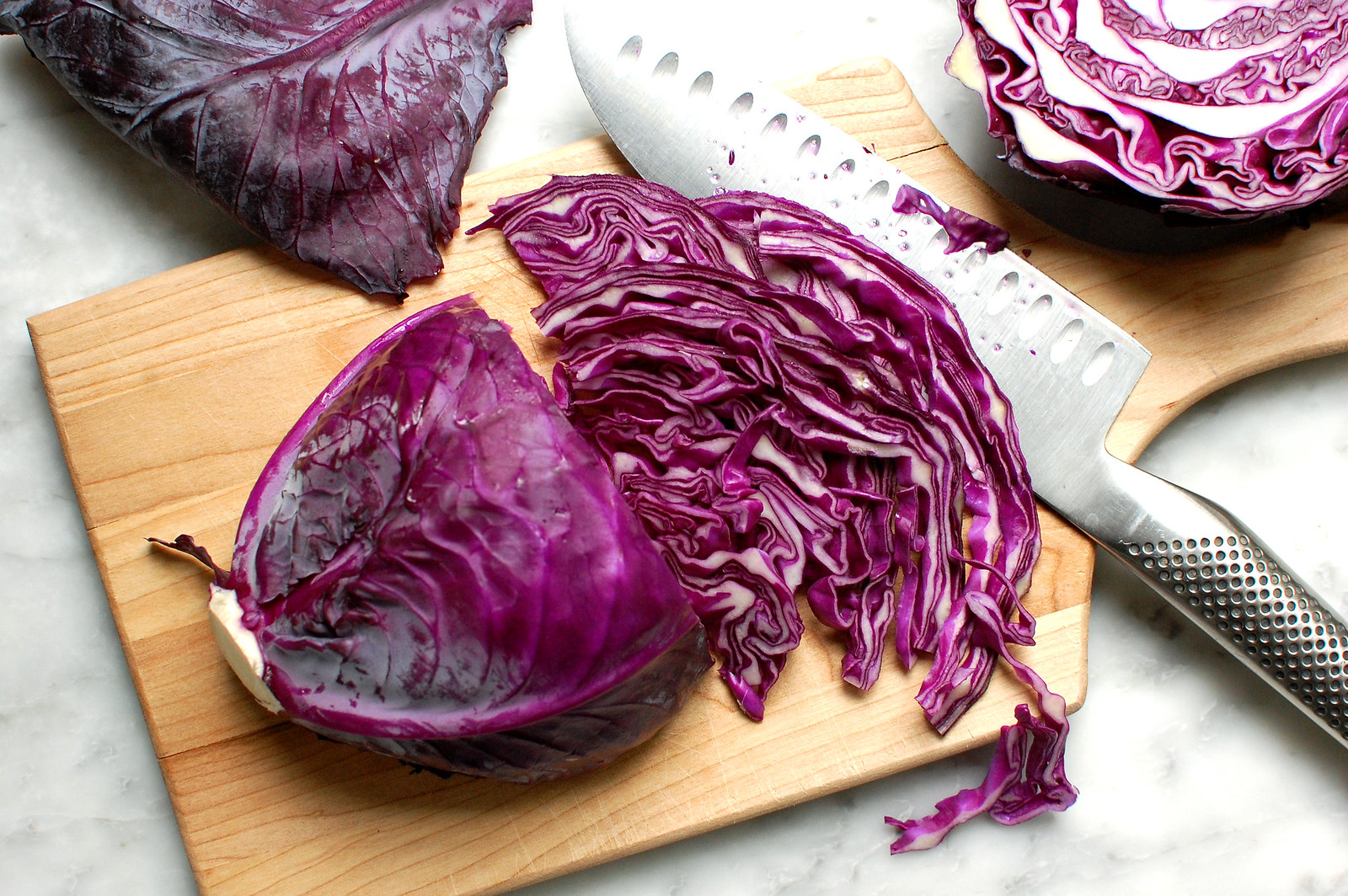 sliced red cabbage on cutting board