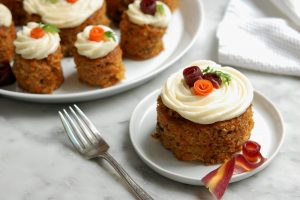 carrot cake with candied carrot peel rosettes on top for decoration