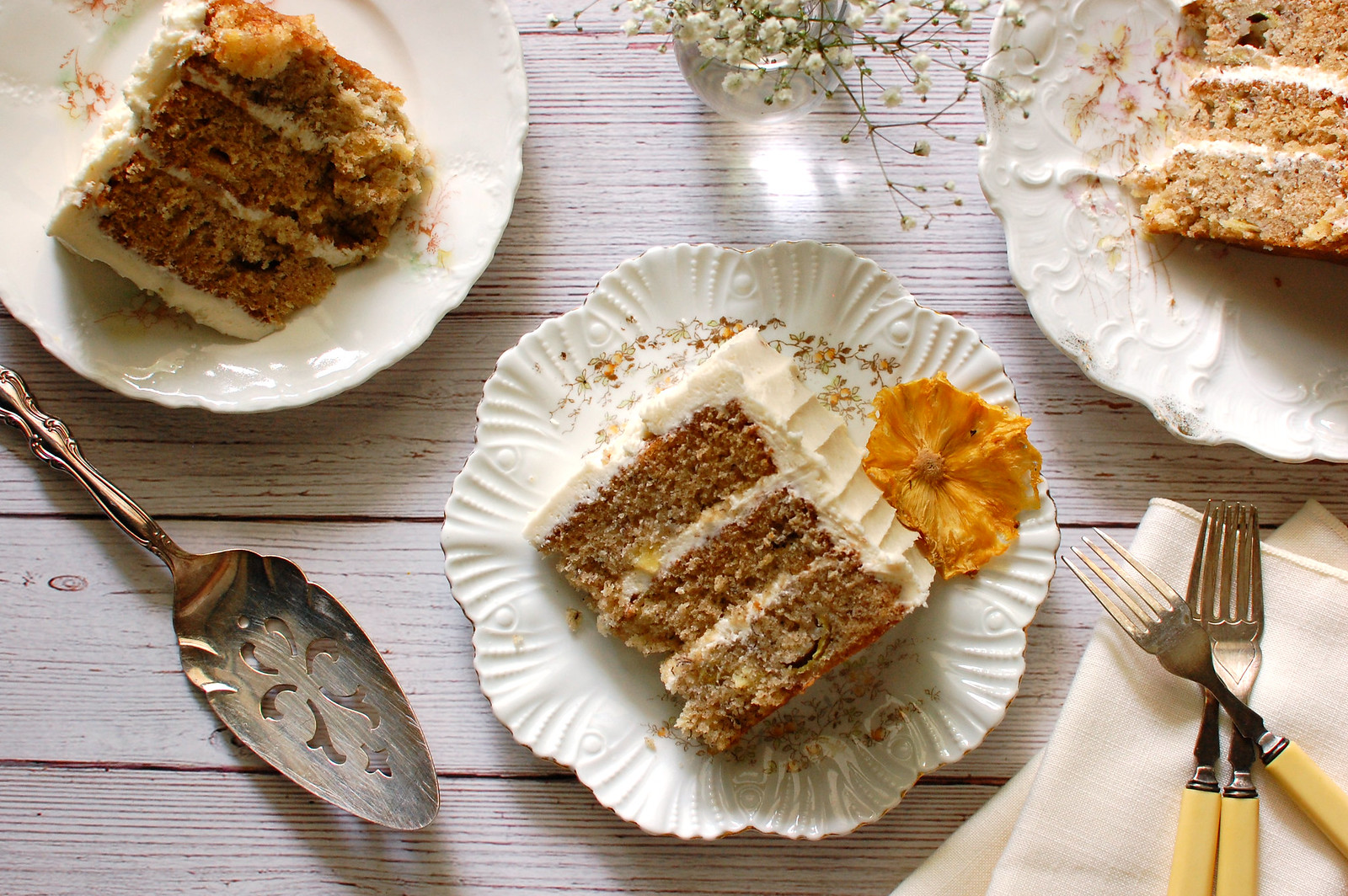 hummingbird layer cake sliced on plate with pineapple flower