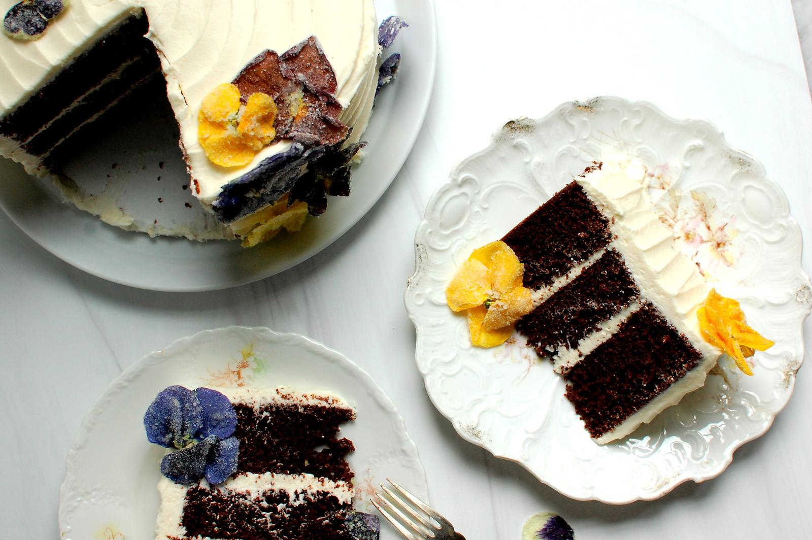 chocolate cake slices with crystallized sugar pansies