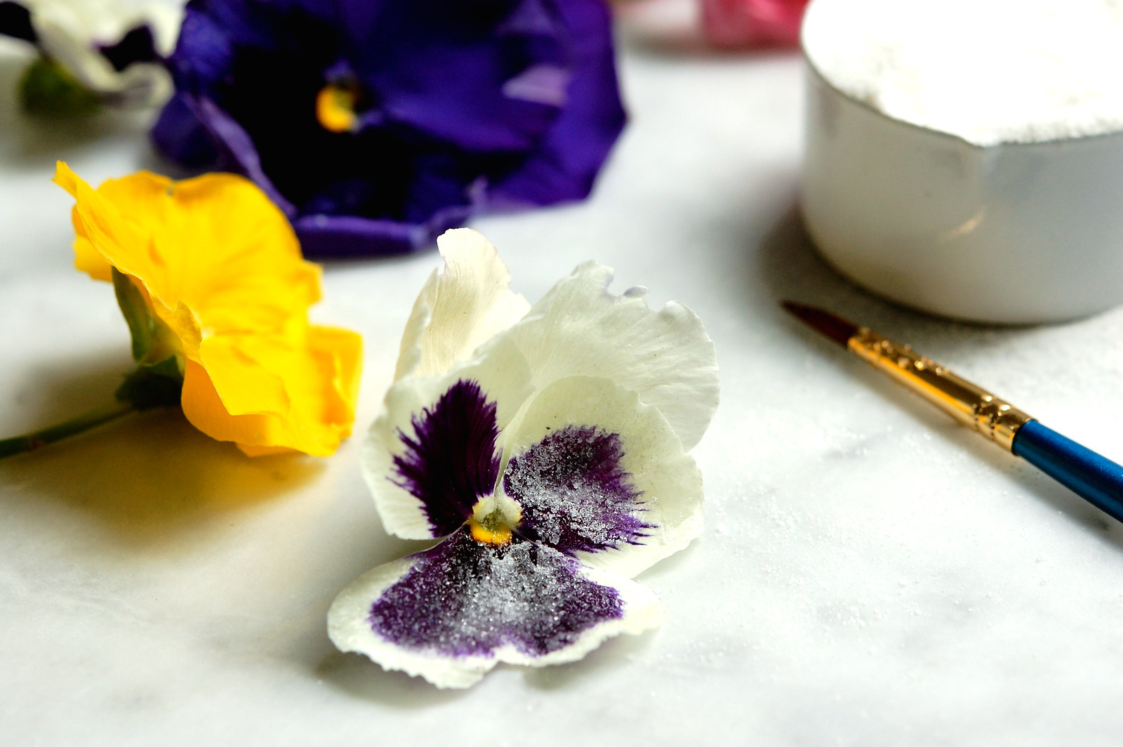 candied crystallized pansies with paintbrush