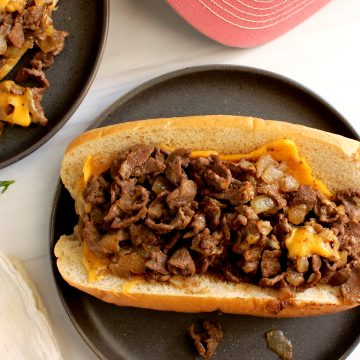 How to Order a Cheesesteak Like a Philly Local cheesesteak with onions