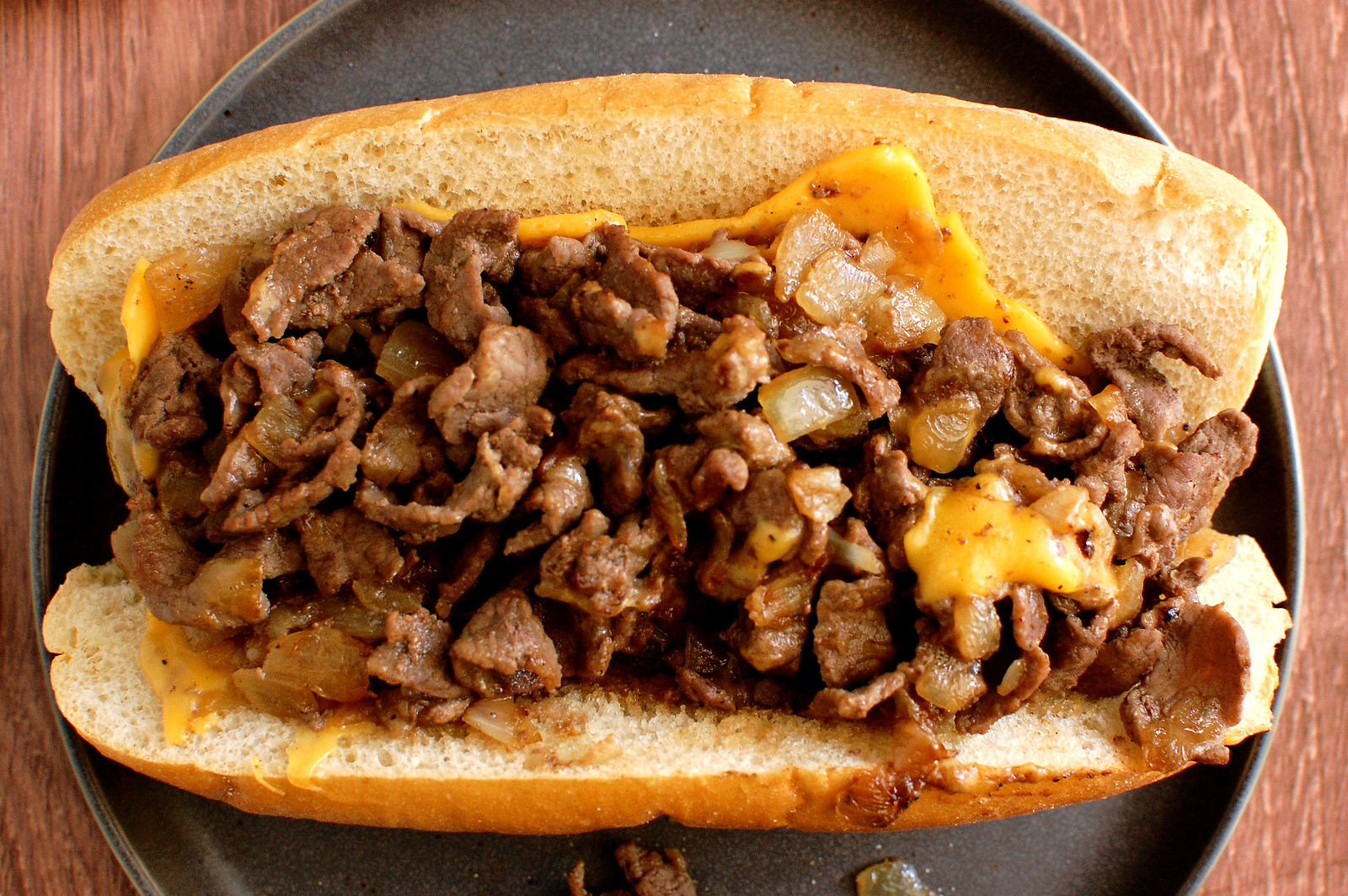 How to Order a Cheesesteak Like a Philly Local cheesesteak on plate