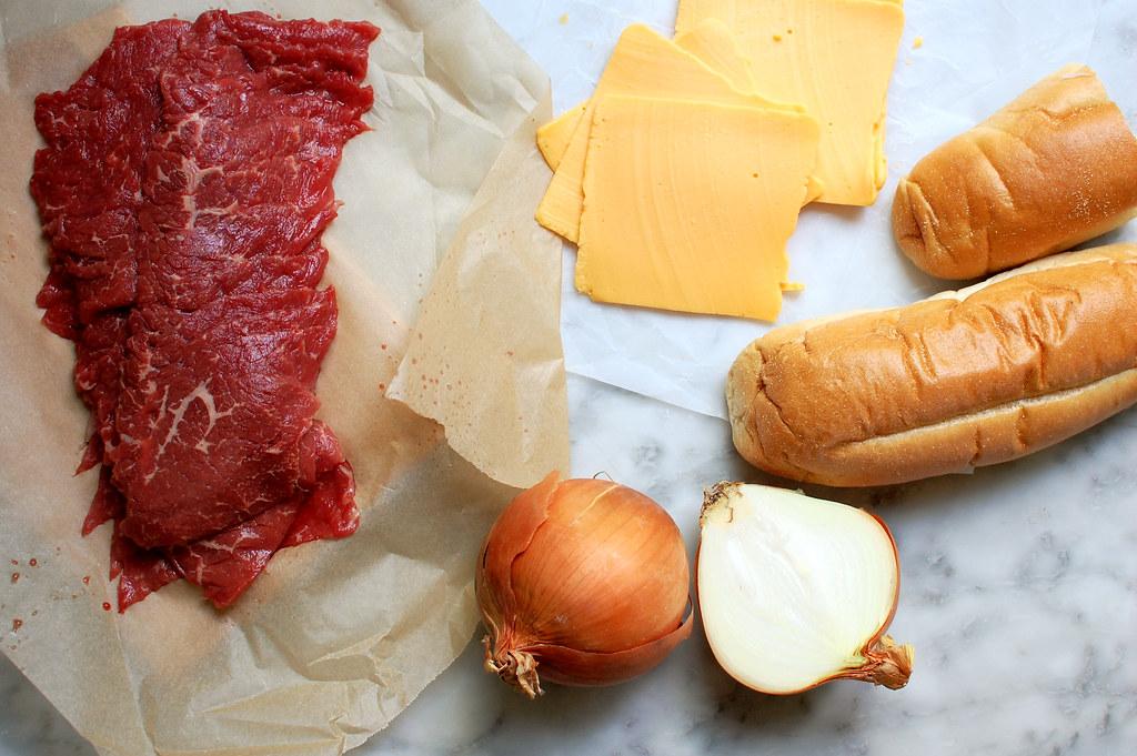 Philly cheesesteak ingredients beef cheese onions hoagie rolls